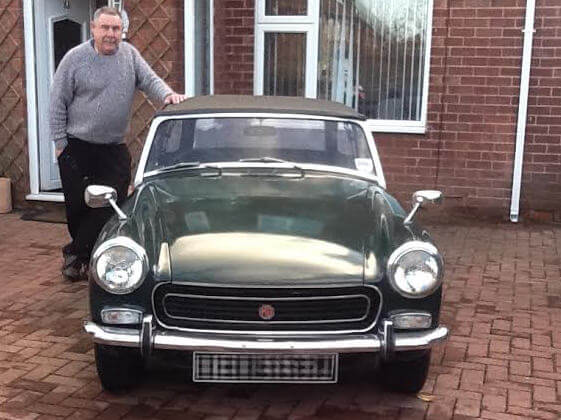 John with the MG Midget he donated to Maurice's wife, Beryl