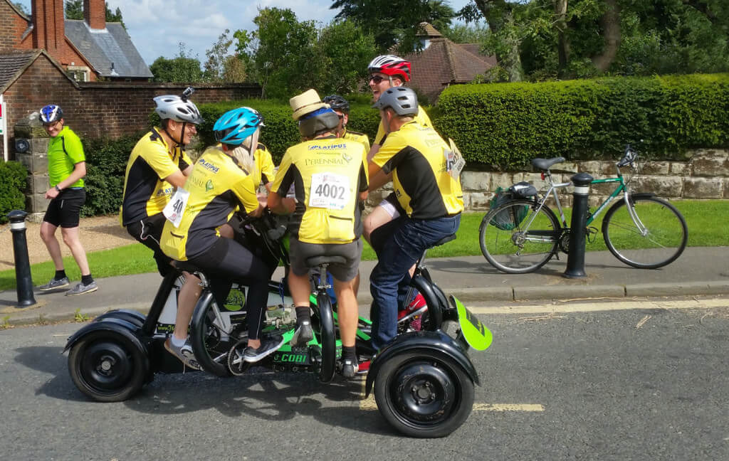 The 7 seater bicycle completing the climb of Turners Hill during the 2015 London to Brighton bike ride.