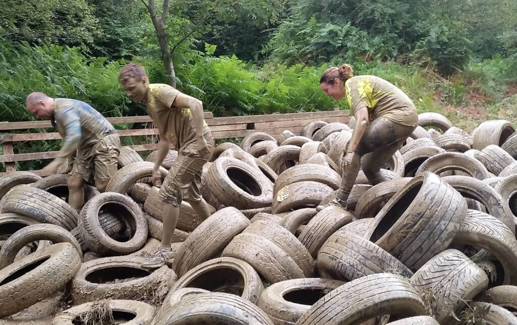 Jamie Butterworth and Claire Vokins tackle the tyre run during the 2015 Nuts Challenge