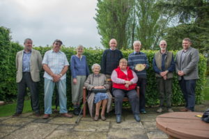 The residents of The Six Houses with the commemorative sundial from The National Gardens Scheme.